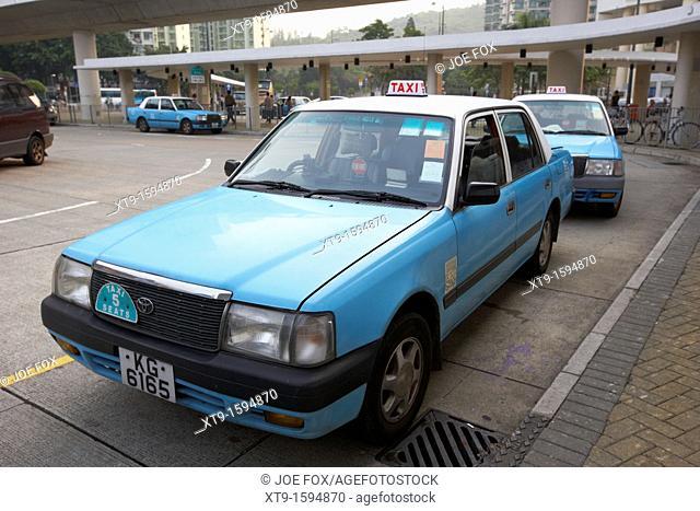 row of lantau island taxis on a taxi rank tung chung hong kong hksar china