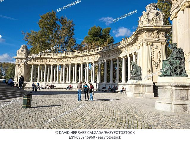 Madrid, Spain - November 13, 2016: Tourist visiting Alfonso XII monument on November 13, 2016 in Retiro park, Madrid, Spain