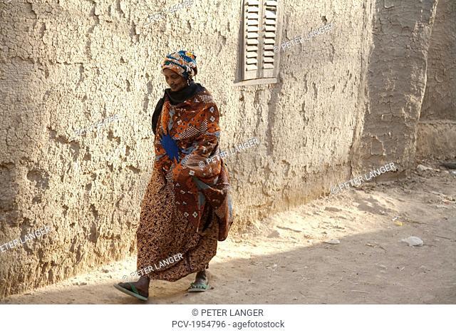 Woman walking on street at Djenne, Mali