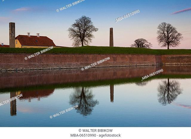 Denmark, Zealand, Helsingor, Kronborg Castle also known as, Elsinore Castle from Shakespeare's Hamlet, castle moat, dusk