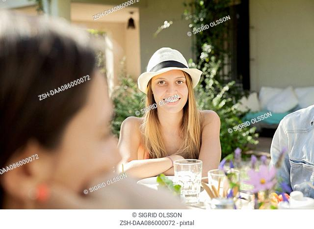 Woman enjoying meal with friends