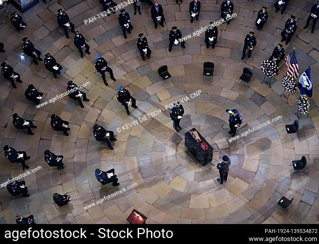 Mourners pay their respects at the funeral service for Capitol Police Officer Brian Sicknick in Washington, DC on Wednesday, February 3, 2021