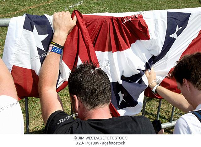 Belleville, Michigan - A 'Patriots in the Park' rally, organized by the Tea Party and Americans for Prosperity  Men wait by a security barrier to hear former...