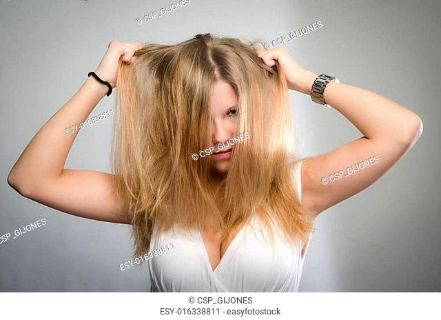 Woman tearing her hair out in frustration