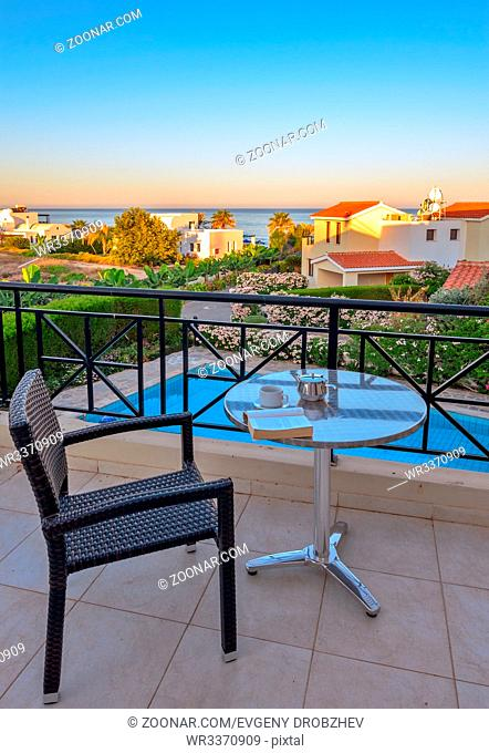 Chair and table for relaxation on terrace with sea view