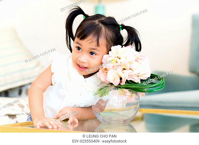 Cute girl take photo with flower