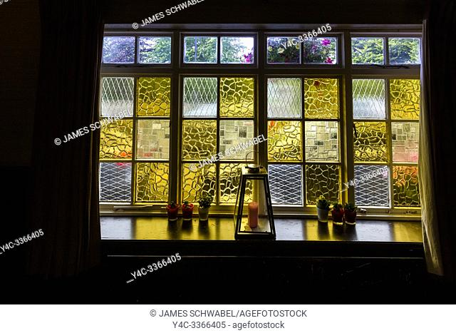Colorful glass window in Corleys Abbey Lodge in Ballintubber County Mayo Irelnad