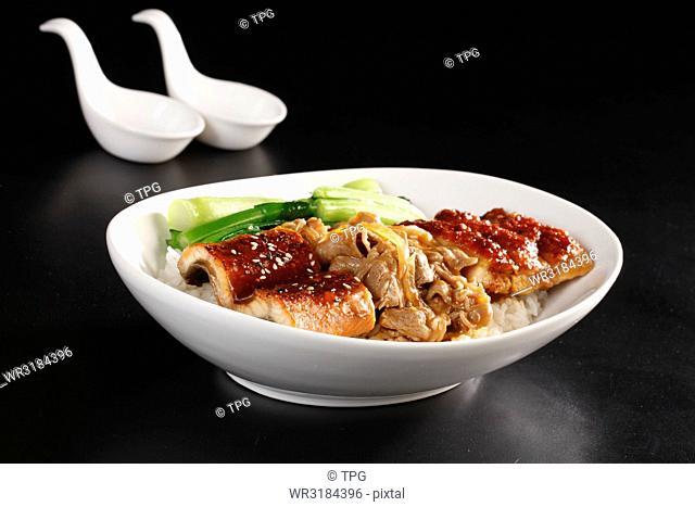 unagi and sliced pork over rice