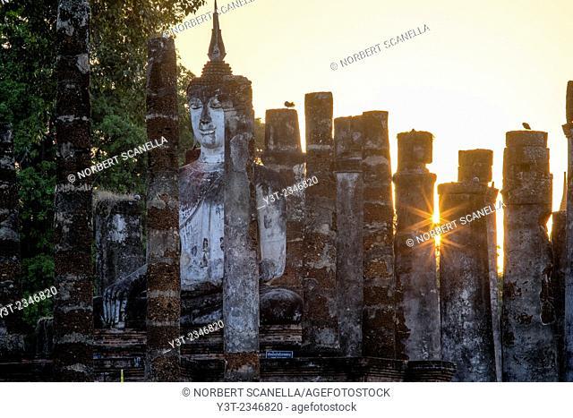 Asia. Thailand, old capital of Siam. Sukhothai archaeological Park, classified UNESCO World Heritage. Wat Mahatat. Buddha statue at sunset