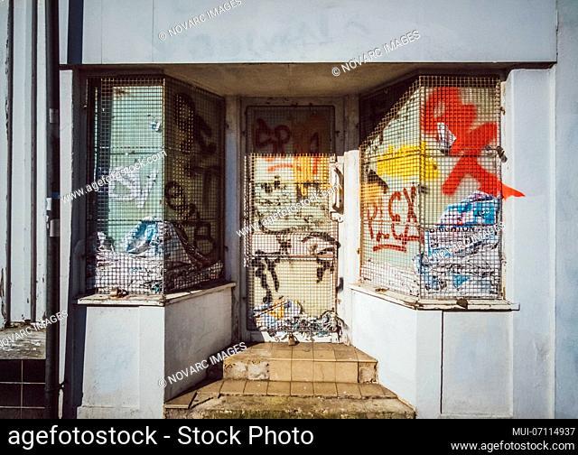 Graffitti on a barred front door, Brighton, England