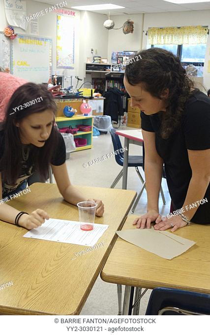 Special Education Student and Teacher Doing Experiment in 7th Grade Science Class, Wellsville, New York, USA