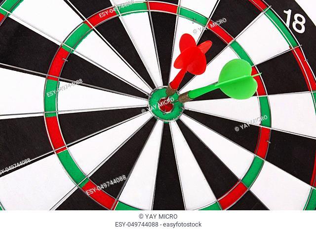 dartboard with two darts closeup