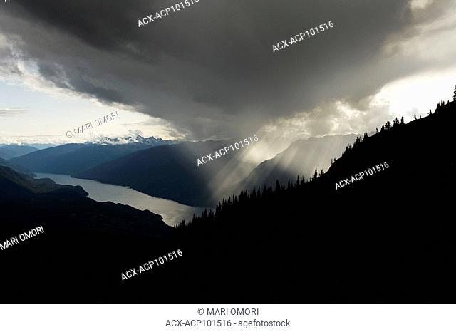 Rays of light breaks through the clouds over Valhalla Provincial Park, as seen from Idaho Peak
