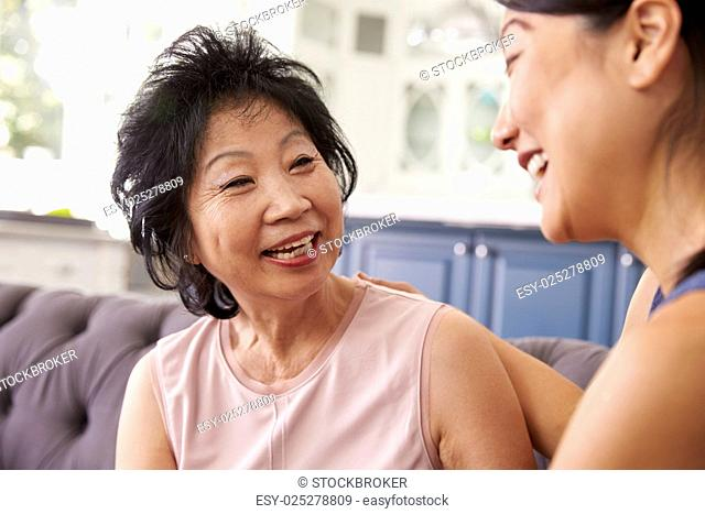 Adult Daughter Talking To Mother At Home
