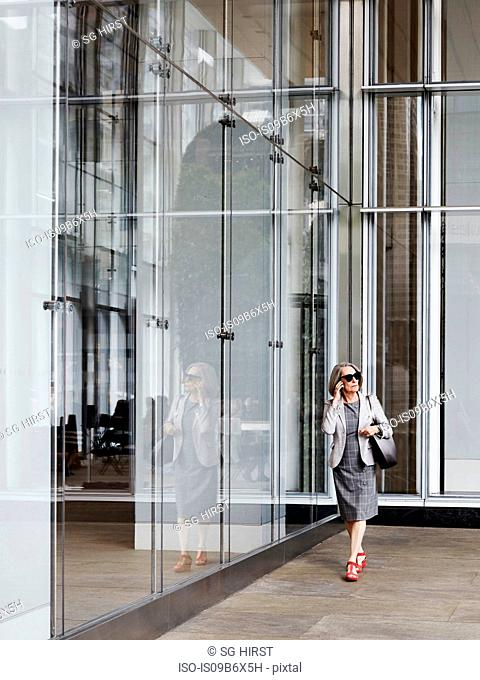 Businesswoman using mobile on the go, New York, USA