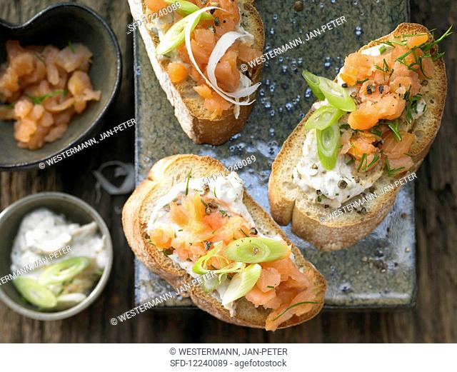 Smoked salmon steak crostini with fresh cheese and horseradish