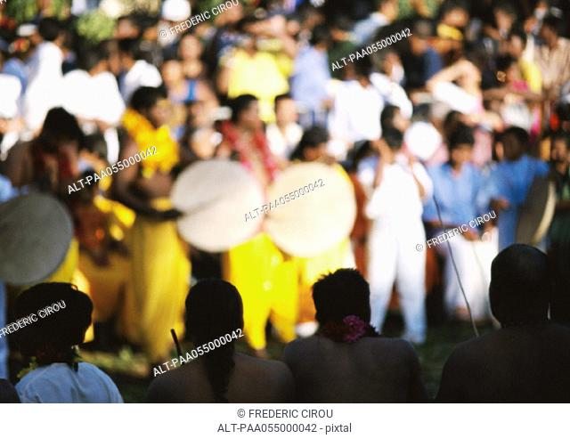 Musicians in a crowd, blurred