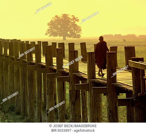 Monk on a teak bridge, U Bein Bridge