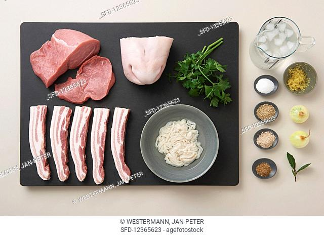 Ingredients for 'Weisswurst' (traditional Bavarian veal and pork sausage): pork, veal, meat from the calf's head, parsley, pork casing and spices