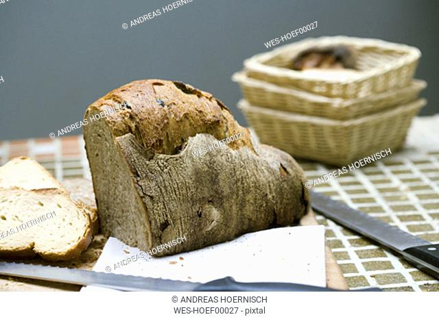 Bread and knife on table