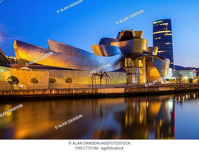 Guggenheim museum in Bilbao  Iberdrola Tower in background  Bilbao, Basque Country, Spain
