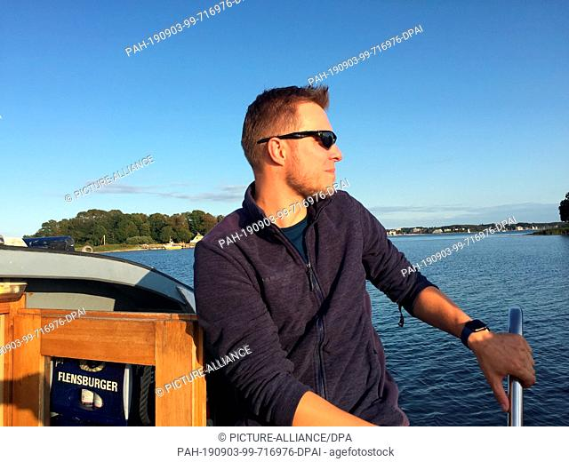 "21 August 2019, Schleswig-Holstein, Flensburg: The Nabu expert Jan Langmaack sits on board the excursion ship """"Flora II"""""