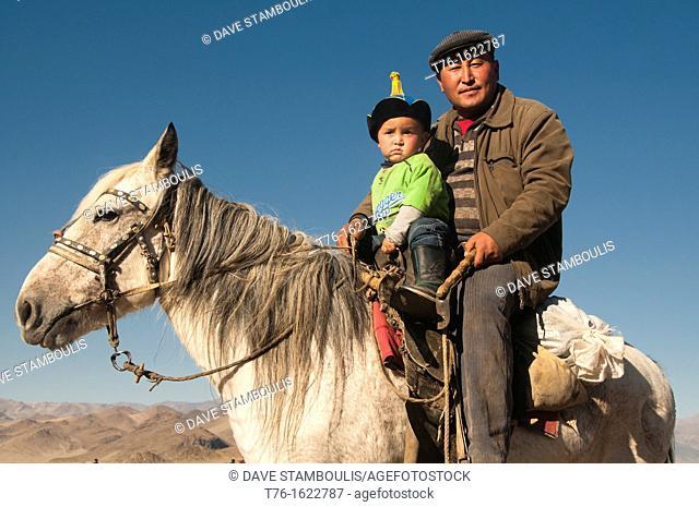 Kazakh father and son on horseback in Bayan-Ölgii in Western Mongolia