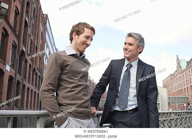 Germany, Hamburg, Two businessmen talking