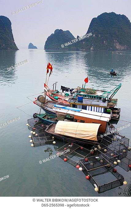 Vietnam, Halong City, Halong Bay fishing boats, dusk