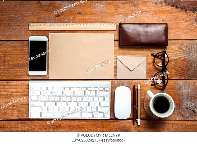 The responsive design mockup on wooden background