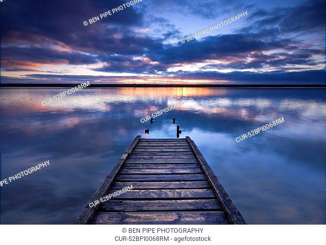 Wooden pier in still lake