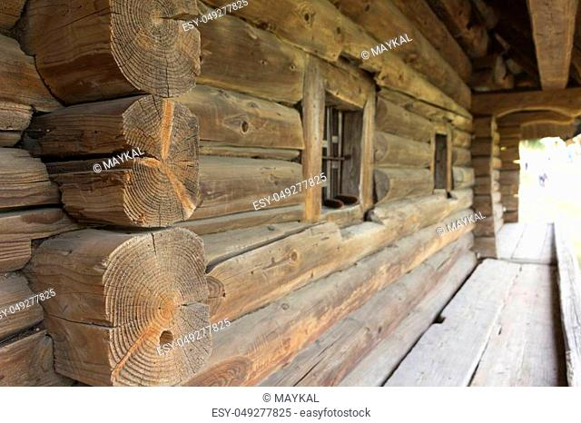 The wall of a very old house with a log house, with gray woods