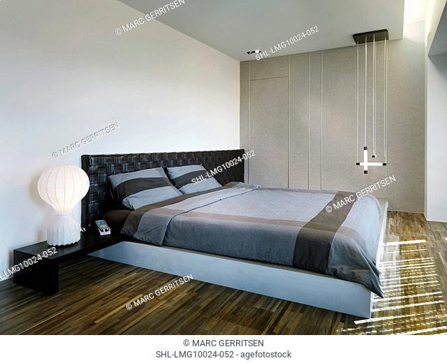 Modern master bedroom with hardwood floors
