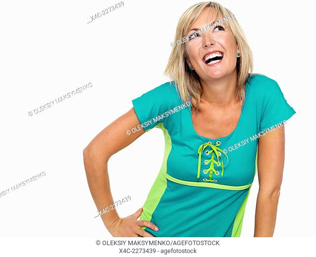 Portrait of a young happy laughing woman in a bright turquoise shirt isolated on white background