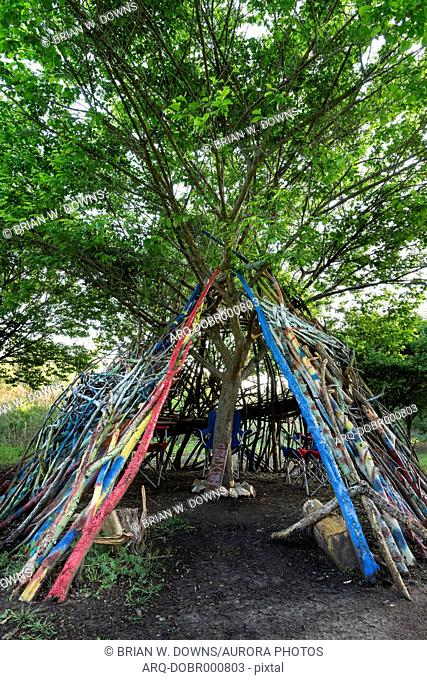 Urban teepee tent fort found in a local city park within Raleigh, North Carolina. The artist desired to create a welcoming place for children to play
