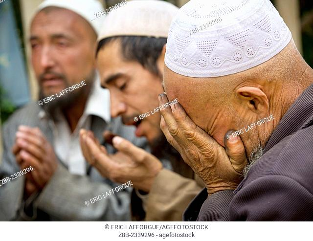 Uyghur Sufi Men Praying At Imam Asim Tomb In The Taklamakan Desert, Xinjiang Uyghur Autonomous Region, China