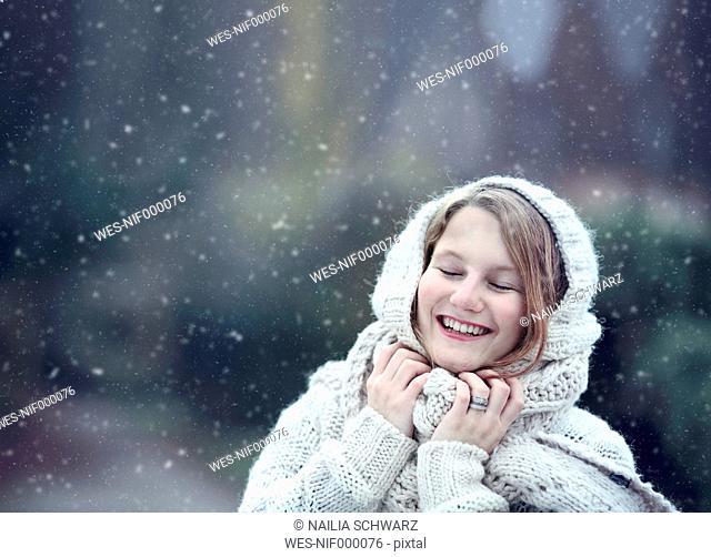 Portrait of happy young woman wearing knitwear in winter