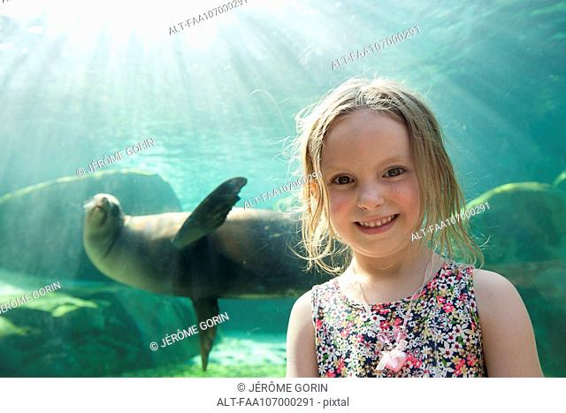 Little girl at aquarium, portrait