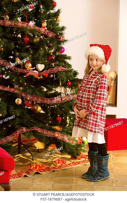 Young girl looking forward for Christmas