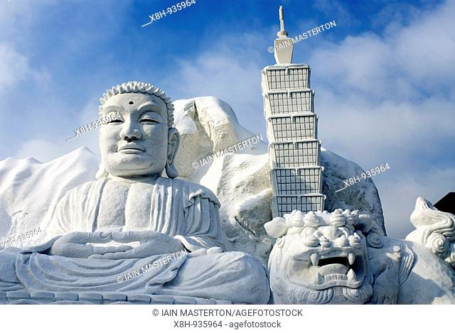 Carved snow sculpture of Buddha and Taipei 101 skyscraper sponsored by Taiwan Tourist Board at Sapporo Snow Sculpture Festival in Japan