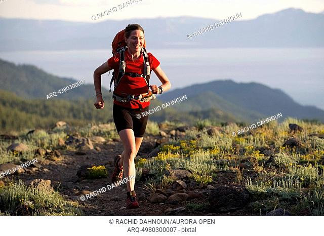 A woman, endurance athlete, fastpacking on the Tahoe Rim Trail