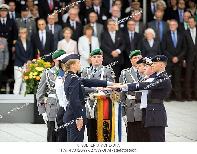 A group of recruits is sworn in on the Bendlerblock parade ground in Berlin, Germany, 20 July 2017. 400 recruits were sworn in during a ceremony on the 73rd...