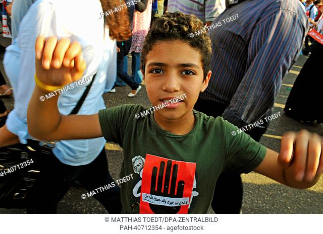 A young protester is on his way to a demonstration against Egyptian President Mursi at Tahrir Square in Cairo, Egypt, 30 June 2013