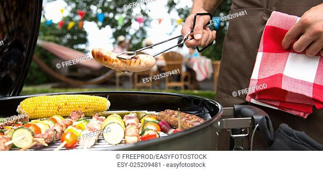 Having a barbecue party in their garden in summer