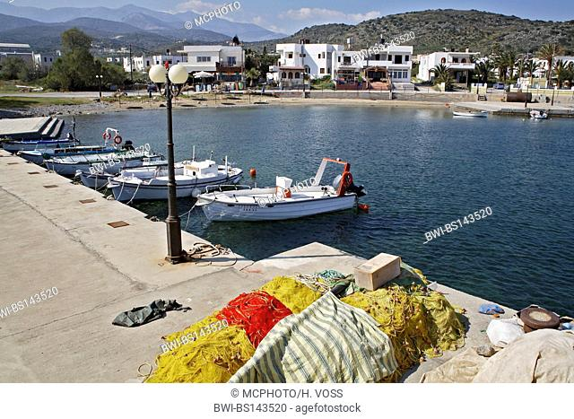 boats and fishing nets in the habour fo Milatos, Greece, Crete