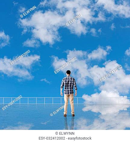 Man look and discover against the cloudy sky with copyspace