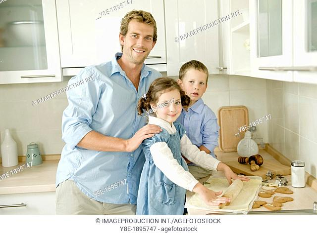 Czech Republic, Father with children (4-5) making cookies
