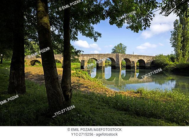 Medieval stone bridge across Dobra near Novigrad in Croatia