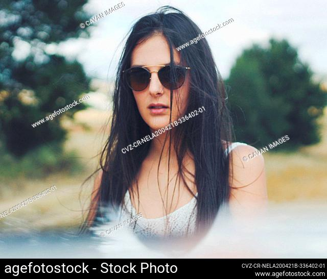 young girl with sunglasses in the field
