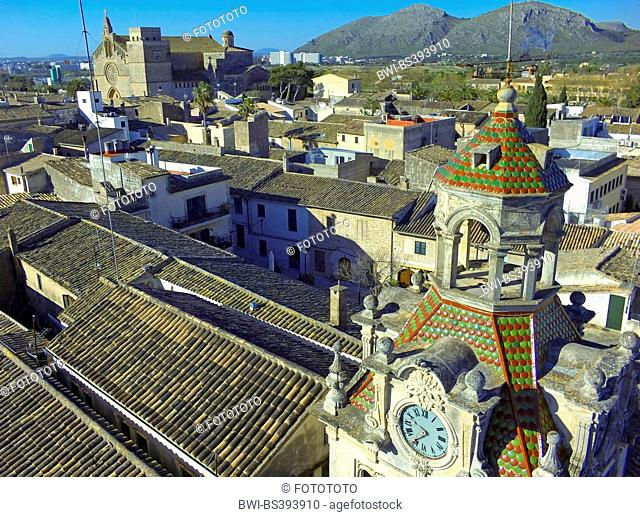 aerial view to city hall tower in the old city of Alc·dia, church of St. Jaume and mountain range Atalaya de Alcudia in background, Spain, Balearen, Majorca